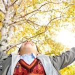 Happy kid in autumn park portrait — Stock Photo #21543125