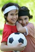 Young boys holding football outside — Stock Photo