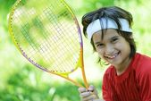 Kid playing tennis — ストック写真