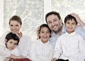 Happy family with kids on the couch — Stock Photo