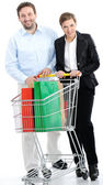 Couple shopping together with cart — Stock Photo