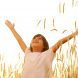 Happy child at harvest field — Stock Photo #22827370