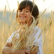 Happy child at harvest field — Stock Photo #22827886