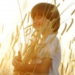 Happy child at harvest field — Stock Photo