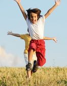Two little boys on field running — Stock Photo