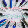 Stock Photo: Pens and handwriting colorful notebook