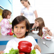 Little boy in kitchen cooking with his family — Stock Photo #26227813