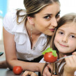 Stock Photo: Mother and daughter cooking, love and work together