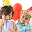 Birthday party, happy children celebrating, balloons and presents around — Stock Photo #26227837