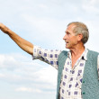 Senior male person making gestures — Stock Photo