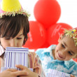 Birthday party, happy children celebrating, balloons and presents around — Stock Photo #26228515