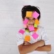 Little boy with memo posts on his face — Stock Photo