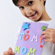 Kid holding message for lovely Mom — Stock Photo #26228799