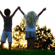 Stock Photo: Happy children in nature at sunset