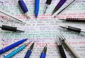 Pens and handwriting colorful notebook — Stock Photo