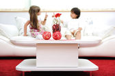 Little brother and sister at home with modern furniture — Stock Photo