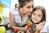 Mother and daughter cooking, love and work together — Stock Photo