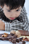 Kid and chocolate nut — Stock Photo
