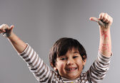 Portrait of little cute boy giving the thumbs-up sign — Stock Photo