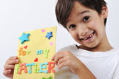Kid holding message for lovely Dad — Stock Photo