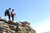 Couple on the top of mountain — Stock Photo