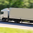 Fast moving truck with white container on highway — Stock Photo