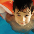Child boy in pool — Stock Photo