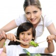 Beautiful mother and little son in kitchen together — Stock Photo #26232267