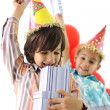 Birthday party, happy children celebrating, balloons and presents around — Stock Photo #26232605