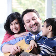 Happy family playing guitar together — Stock Photo