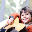 Stock Photo: My son playing guitar at home