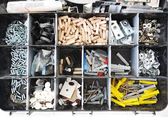 Toolbox with arranged screws — Stock fotografie