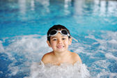 Little boy in pool water — Stock Photo