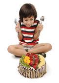 Kid eating cake — Stock Photo