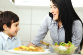 Little boy in kitchen with mother — Stock Photo