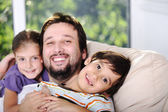 Father son and daughter at home — Stock Photo