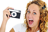 An excited teenage girl shouting holding a retro camera in hand — Foto de Stock