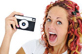 Excited girl with retro camera — Stock Photo