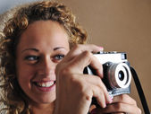 Blonde girl with retro camera — Stock Photo