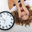 Girl and clock panic — Stockfoto