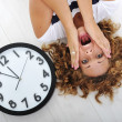 Girl and clock panic — Stock Photo
