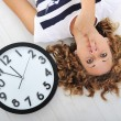 Girl and clock silence secret — Stock Photo