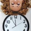 Stock Photo: Girl and clock upside down