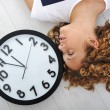 Girl and clock — Stock Photo