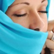 Young beautiful muslim woman in blue scarf — Stock Photo #26242693
