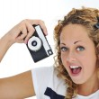 An excited young woman shouting holding a retro camera in hand — Foto Stock