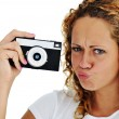 Stock Photo: Cute girl with camera isolated