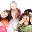 Group of playful children in studio — Stock Photo