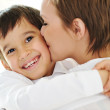 Happy mother embracing and kissing her son — Stock Photo #26245081