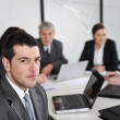 Portrait of businessman in the office at meeting — Stock Photo